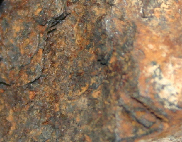 "the surface is ""coated"" by a layer of rust"